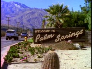 stock-footage-welcome-to-palm-springs-sign-along-highway-leading-to-palm-springs